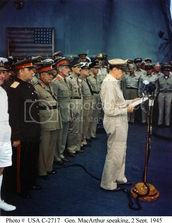MACARTHUR READS THE ARTICLES OF CAPITULATION ABORAD USS MISSOURI BB-63 JUNE 1945